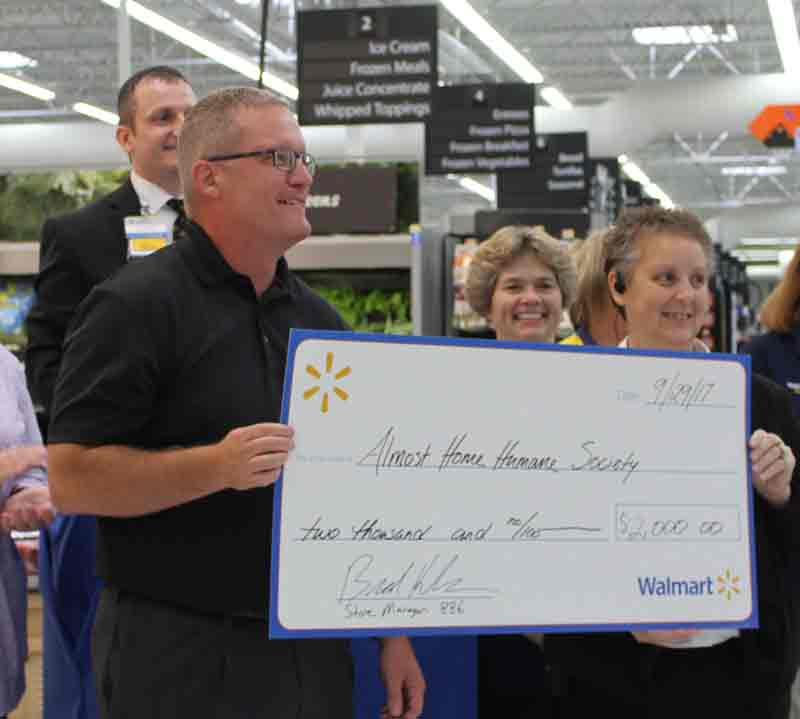 The Fort Dodge Walmart store recently donated to Almost Home. Pictured from left are store Manager Brad Henderson, Chad Hammer, HR Manager Kim Scott and Co-manager Sabrina Wohlford.