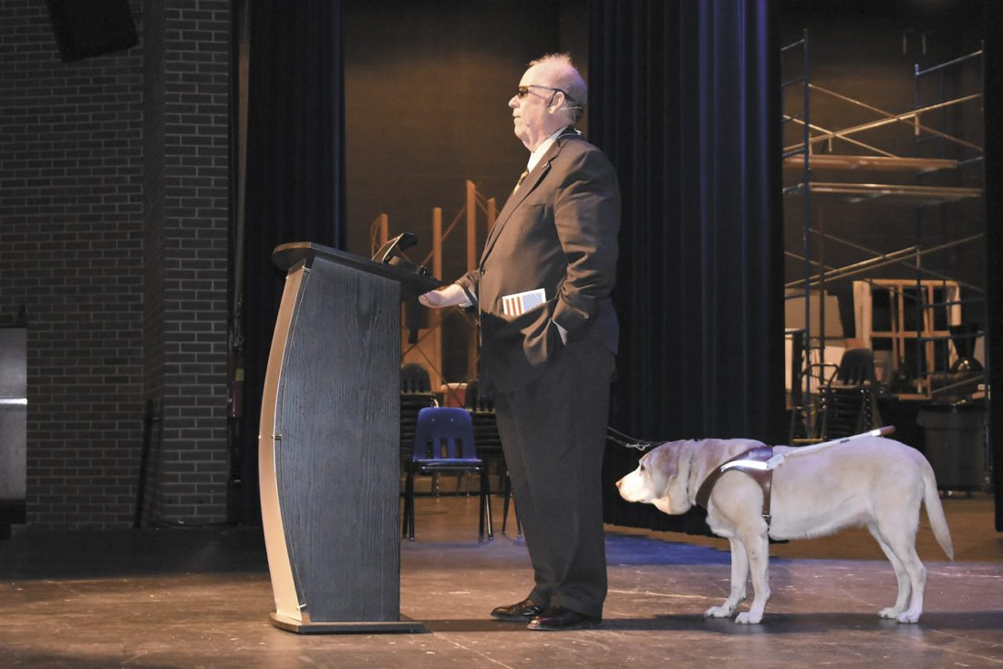 -Messenger photo by Chad Thompson  Michael Hingson stands with his guide dog, Africa, inside Decker Auditorium on the main campus of Iowa Central Community College Monday night. Hingson shared his story on how he escaped the Twin Towers in New York City on Sept. 11, 2001.
