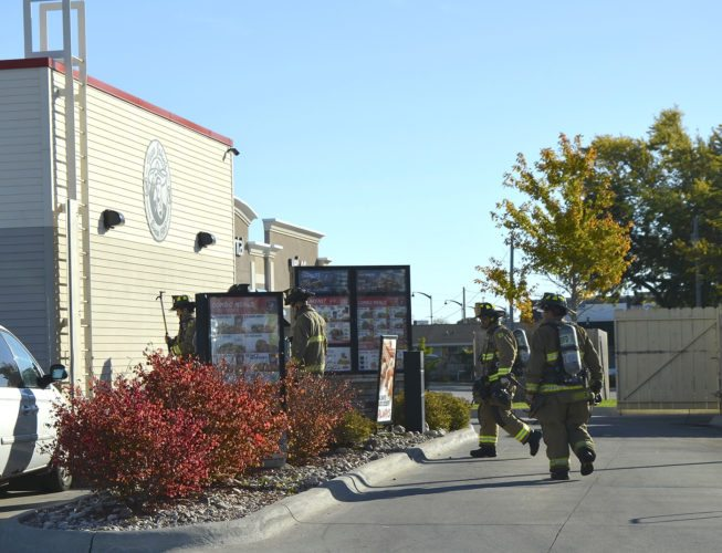 -Messenger photos by Joe Sutter  Fort Dodge firefighters arrive at Taco John Monday morning after a report of smoke in the building. Lt. Jeff Hill said the smoke likely came from a furnace unit that hadn't been used all summer.