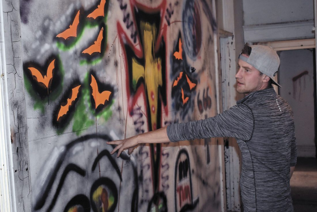 -Messenger photo by Chad Thompson  Tim Goodale, of Fort Dodge, shows off some of the spooky art he helped create inside the Fort Dodge Fear Factory.