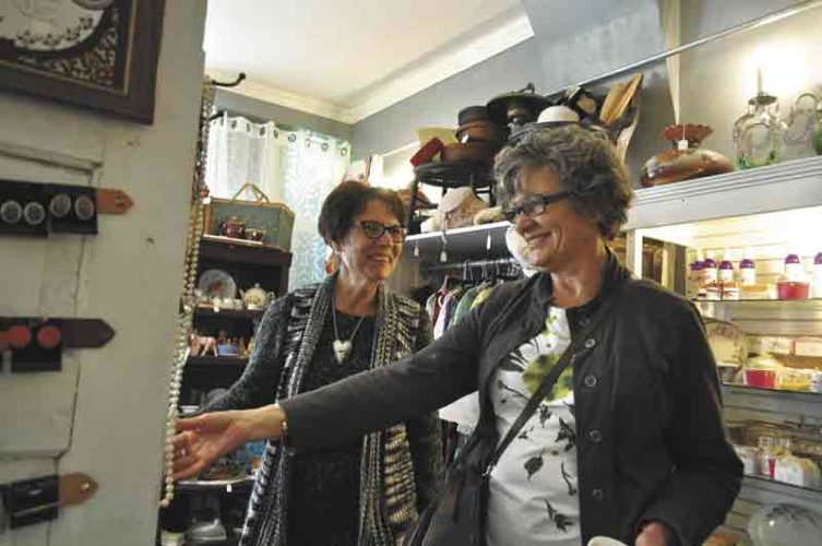 -Messenger file photo  Holly Martin and Kathy Theobald, both of Webster City, peruse items at SOS Vintage during the 2016 Ladies Night Out in Webster City.