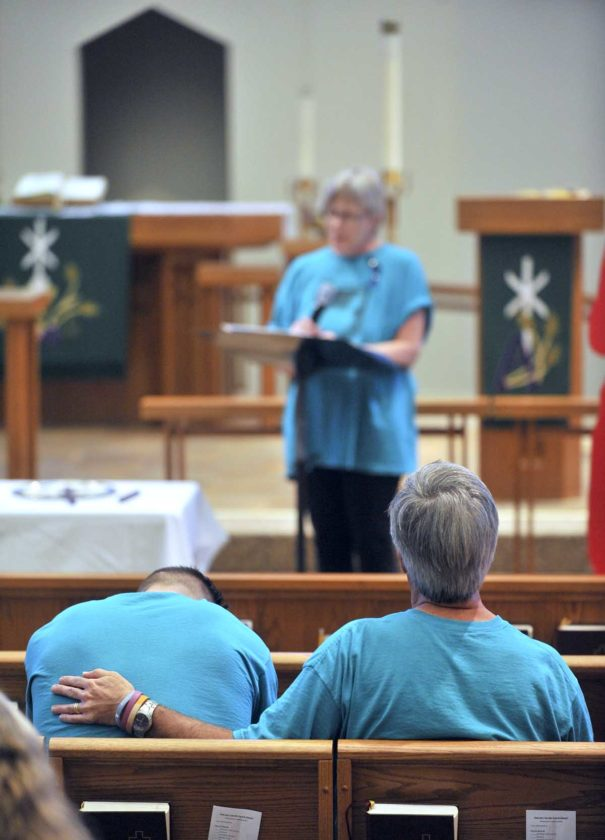 -Messenger photo by Hans Madsen  Scott Campbell, of Des Moines, at left, is comforted by his dad, Doug Campbell, as Vicki Campbell speaks about the loss of her daughter, Heather Campbell, during the 2017 Domestic/Sexual Assault Outreach Center domestic violence candlelight vigil at St. Paul Lutheran Church in Fort Dodge. Heather Campbell was killed on June 11, 2010.