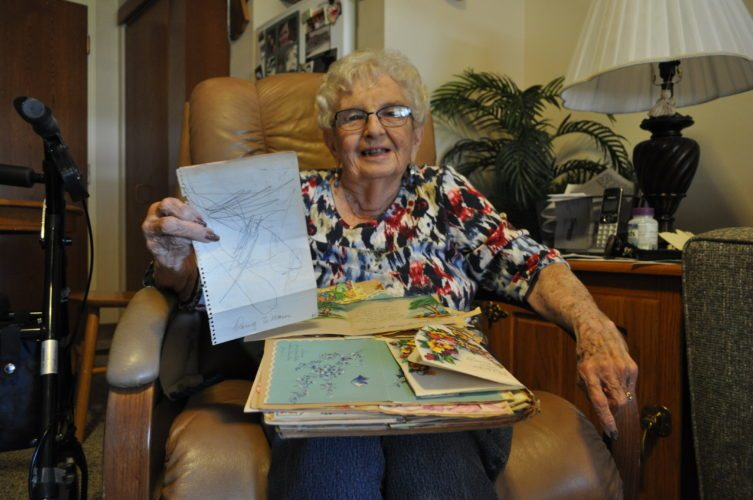 -Messenger photo by Adri Sietstra  Mary Ann Bailey Hammitt, 86, of Webster City, still has a scrapbook of cards and letters she received while in the hospital recovering from polio in 1954. The letter she is holding was made by her son, Doug Bailey, who was 3 years old at the time.