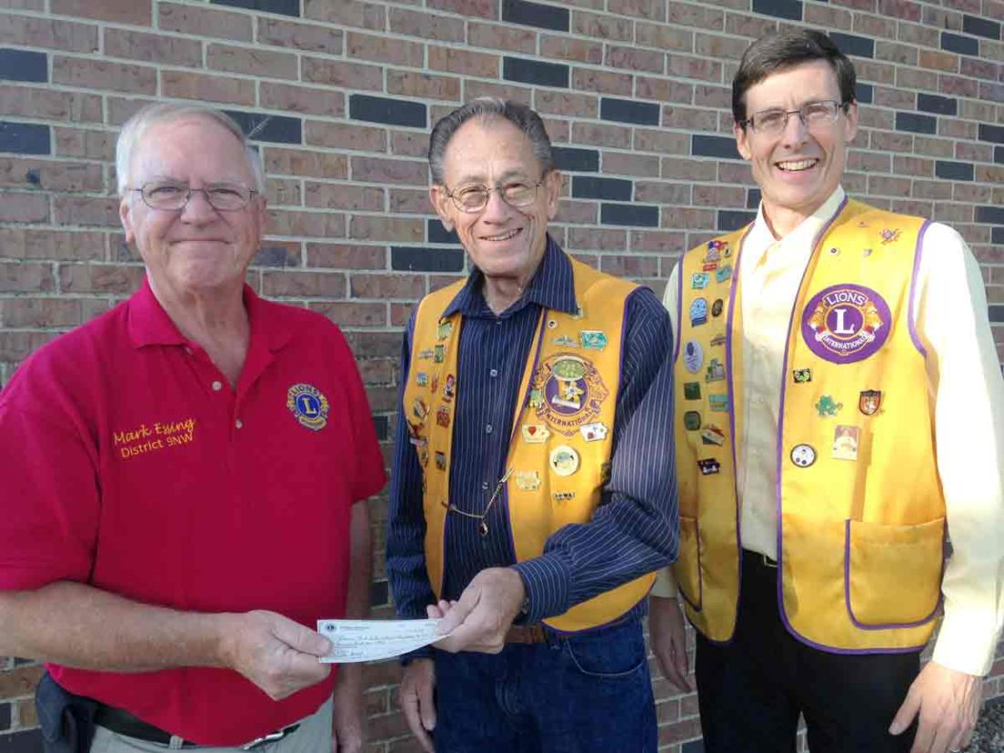 Mark Essing, left, Lions Club International Foundation representative, accepts a check from Jim Dexter, Badger Lions Club treasurer, and Club President Roger Curtis. The funds designated for disaster relief totaling $831 is from profit and donations recently received from the pancake fundraiser in Badger.