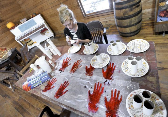 -Messenger photo by Hans Madsen  Fort Museum and Frontier Village Assistant Curator Jessica Einwalter works on making spooky candles and bloody handprints Wednesday that this will used during the Haunted Museum Tour: Lott's Revenge. The spooky event is scheduled for Friday and Saturday starting at 6 p.m. and ending at 10 p.m.