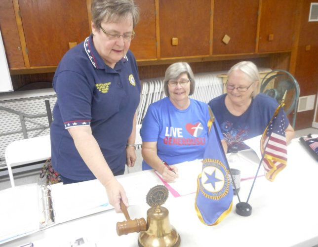 -Messenger photo by Karen Weld President Jo Ann Kramer hammers the meeting open with the gonging of its bell at a recent meeting of Clarion's American Legion Post 246 Auxiliary. Also pictured are Secretary Cindy Riley and Treasurer Brenda Grummitt.