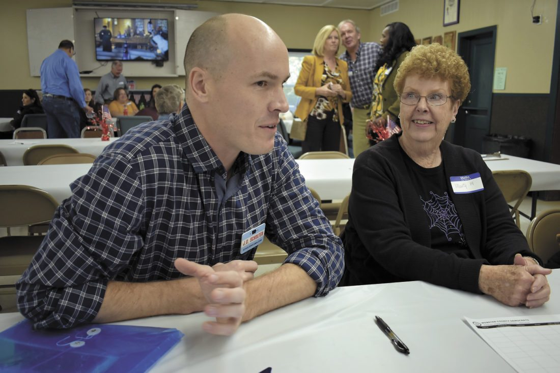 -Messenger photo by Chad Thompson  J.D. Scholten, of Sioux City, visits with attendees during the Webster County Democrats annual pork chop dinner Sunday night at the Noon Lions Den. Mary Minnick, of Rockwell City, looks an at right. Scholten is a candidate for Iowa's Fourth Congressional District.