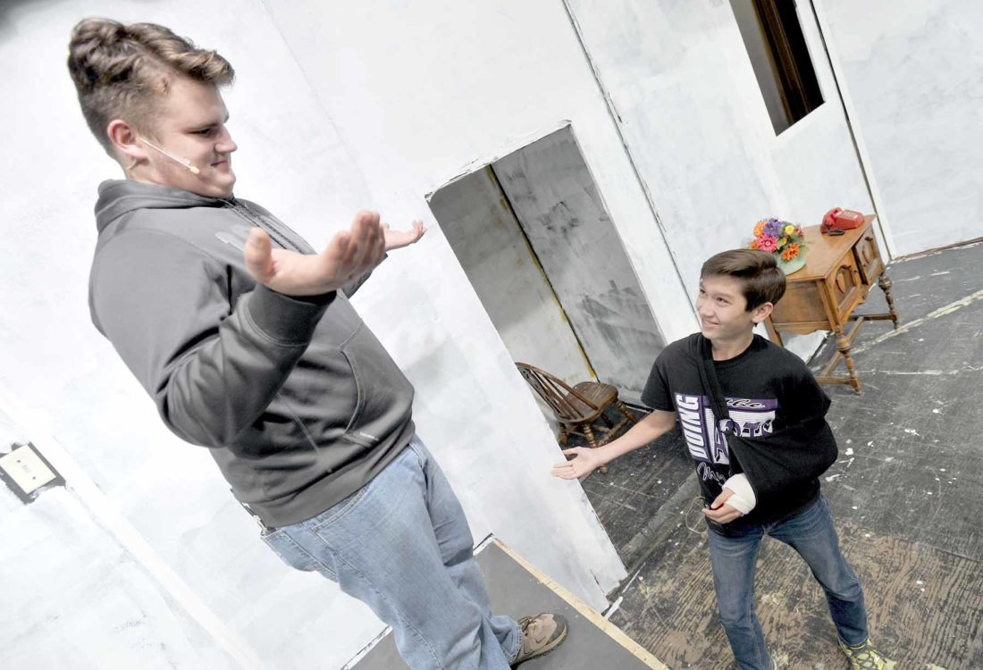 """-Messenger photo by Hans MadsenBurglar partners Howie, played by Jacob Laird, 16, at left, and Merle, portrayed by Josh Meier, 14, rehearse a scene from the Fort Dodge Senior High Fall Play production of """"You Can't Beat the House."""""""
