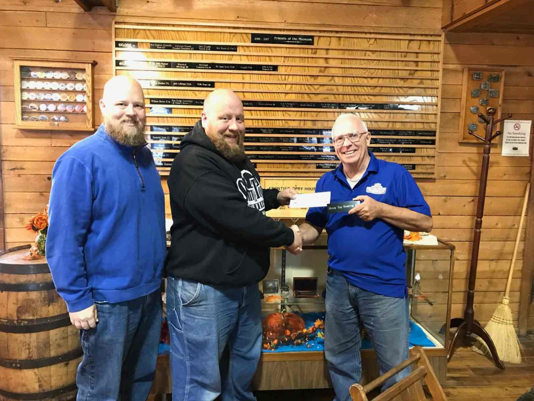 ShinyTop Brewing donated $400 to the Fort Museum and Frontier Village from the sale of Fort Ale, a beer made specially for this cause. Nate McCubbin and Todd McCubbin, from ShinyTop, are pictured with Fort Dodge Historical Foundation President Sam Ashton.