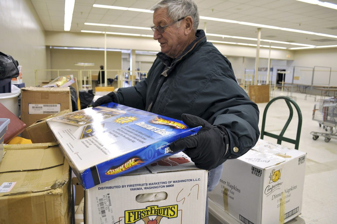 -Messenger file photo by Joe Sutter  Merlin Anderson stacks boxes onto a hand cart in preparation for Operation Christmas 2013. Volunteers will be on hand this year starting Nov. 14 at the Trolley Center for the group's last Operation Christmas.