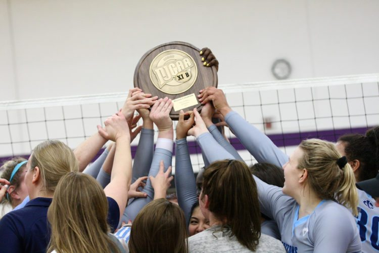 —Photo by Paul DeCoursey  The Iowa Central volleyball team holds their trophy after earning a national tournament berth.