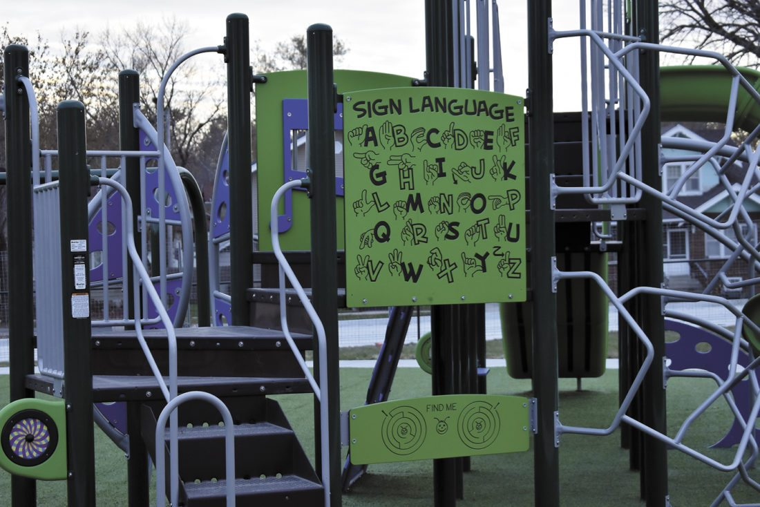 -Messenger photo by Chad Thompson  A sign language chart is shown with the recently added playground equipment at the new Duncombe Elementary School.