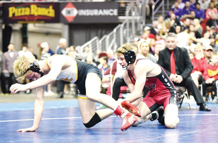 Messenger photo by Britt Kudla  Brody Teske of Fort Dodge wrestles against Southeast Polk's Gauge Perrien last season during the state championship round. Teske is a three-time defending champion for the Dodgers.