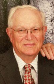 JOHN E. FEVOLD