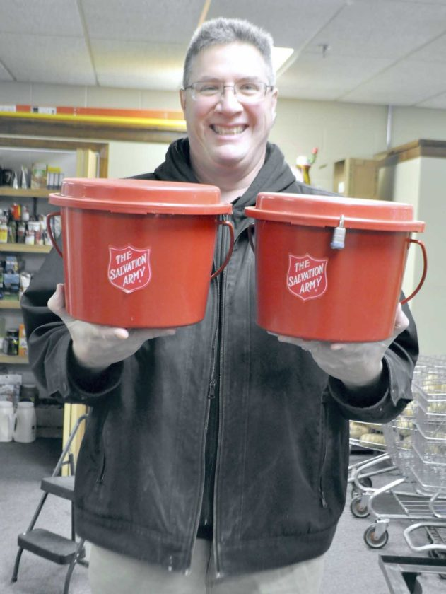 -Messenger photo by Peter Kaspari  Capt. Rick Hamelund, of The Salvation Army, holds two Red Kettles that will be used during The Salvation Army's annual Red Kettle campaign this winter. The campaign kicks off Nov. 16 and goes through Dec. 23.