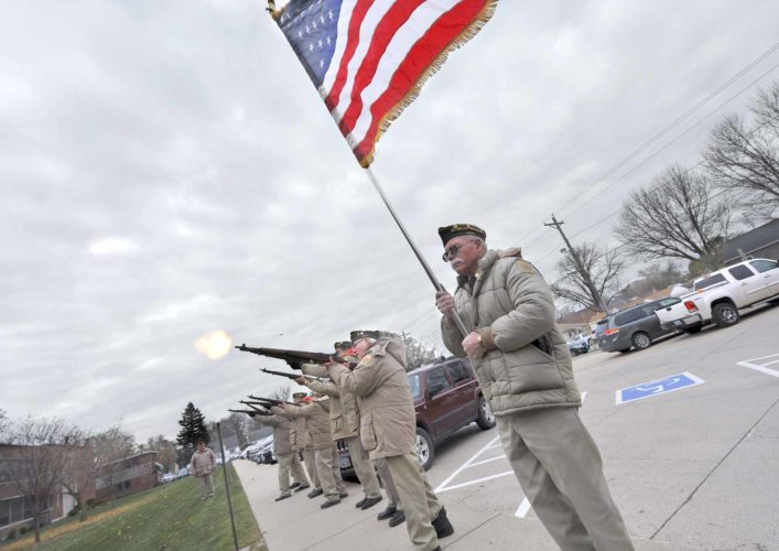 -Messenger photo by Hans Madsen  Members of Veterans of Foreign Wars Post 1856 fire a salute Friday morning during Veterans Day ceremonies at St. Edmond Catholic School.