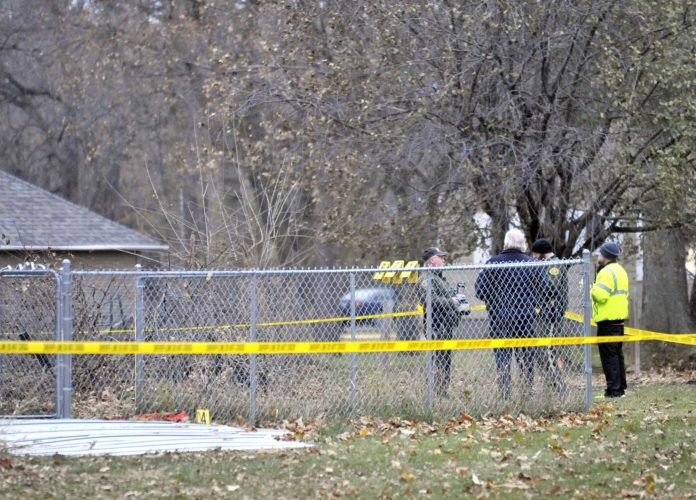-Messenger photo by Hans Madsen  Humboldt police officers and Humboldt County Sheriff's deputies keep the scene of an officer involved shooting secure later Saturday afternoon at 205 Fourth St. S. in Dakota City.