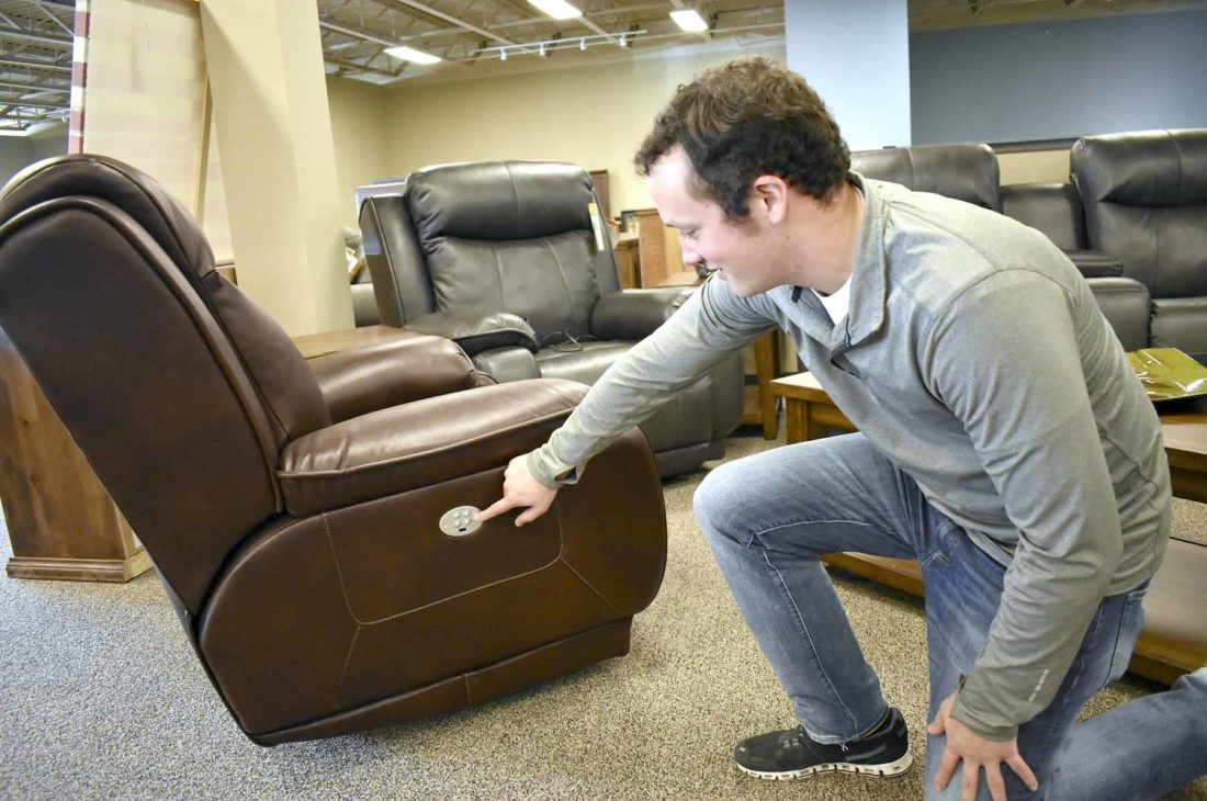 Messenger Photo By Chad Thompson Justin Mikos, Store Manager Of Mikos And Matt  Furniture, Shows Off Some Of The Electronic Functions Of A Recliner At The  ...