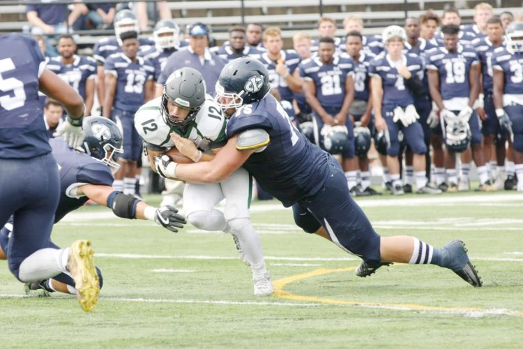 —Photo by Paul DeCoursey  Tim Butcher, a Manson Northwest Webster graduate, makes a tackle for Iowa Central earlier this season. In their last game as Tritons on Saturday, Butcher and the sophomores went out a winner, stunning seventh-ranked Butler on the road, 7-0.