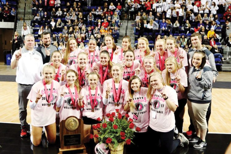 —Submitted photo  Fort Dodge graduate matt johnson (white shirt) stands with the Cedar Falls volleyball team after winning the Class 5A state championship in Des Moines on Friday.