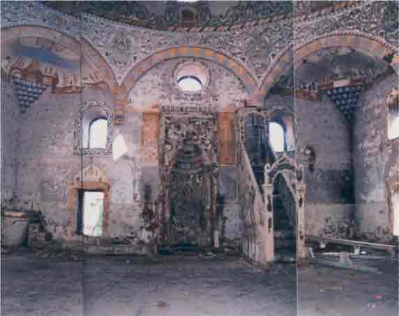 -Submitted photo  This before shot shows how the Bajrakli mosque in Peje, Kosovo, was damaged during the conflict of 1999. Samir Zajmi's organization helped bring in experts from Italy to perform restoration work on this mosque and on Catholic and Orthodox Christian sites.