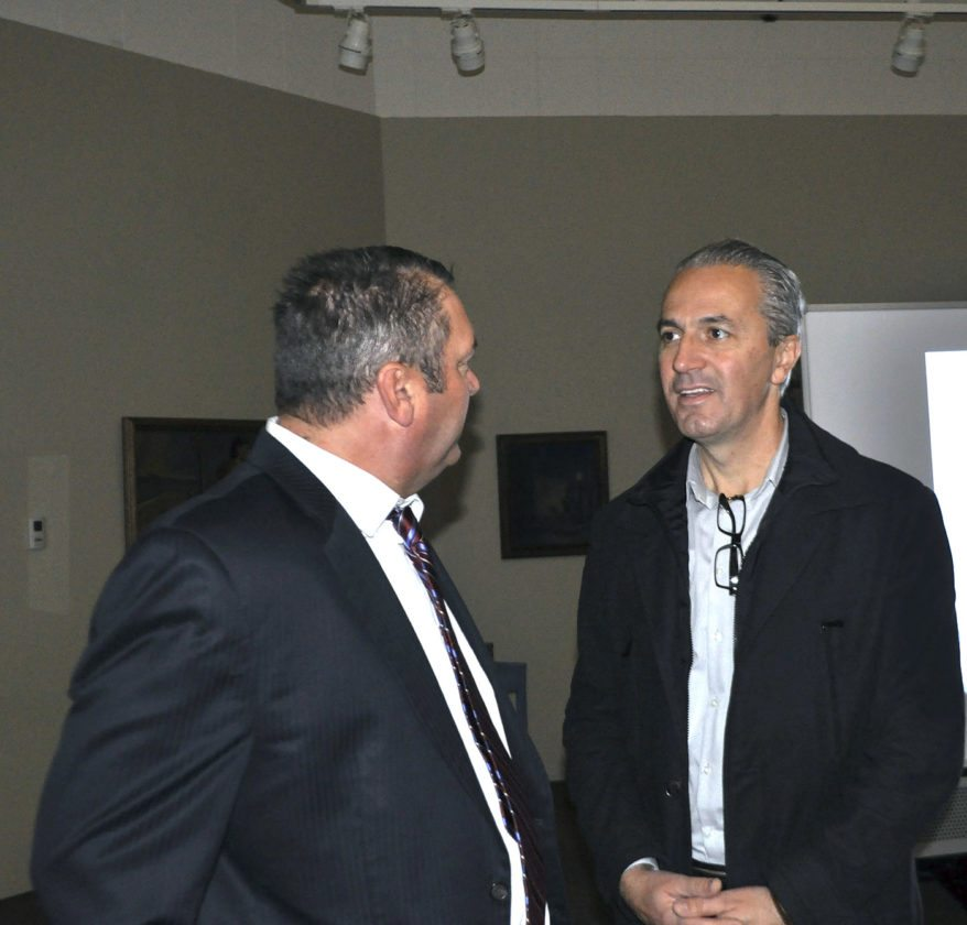 -Messenger photo by Joe Sutter  Iowa Central President Dan Kinney talks with Samir Zajmi at the Blanden Memorial Art Museum Monday morning. Zajmi presented on the ways his organization has been bringing diverse people together through art and culture in Kosovo.