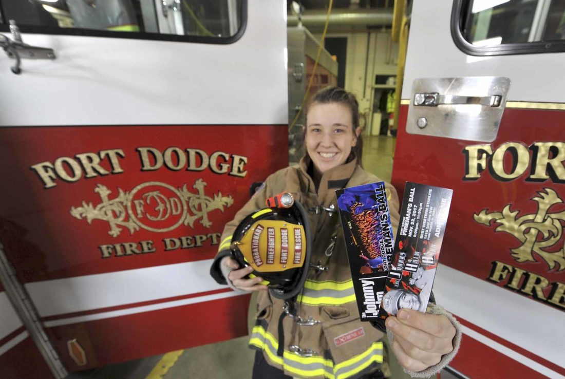 -Messenger photo by Hans Madsen  Fort Dodge Fire Department probationary firefighter Ashley Jochum holds a pair of tickets to the upcoming Fort Dodge Fireman's Ball featuring the Johnny Holm Band. The event is on Nov. 22 from 8 to 11:30 p.m. at the Best Western Starlite.