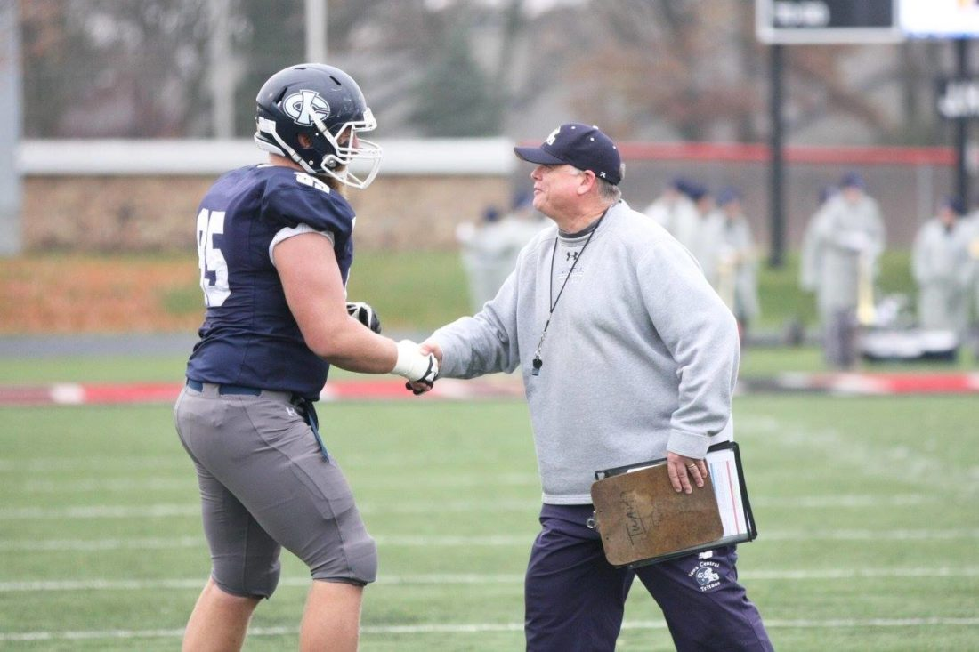 Photo by Paul DeCoursey  Iowa Central football coach Kevin Twait shakes the hand of Jacob Giese during the Tritons' finale home game at Dodger Stadium this year.