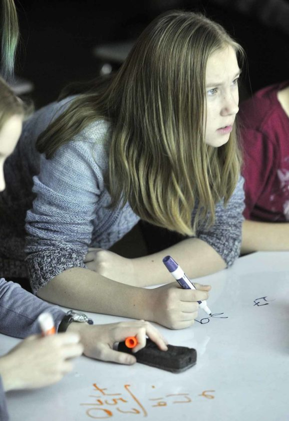 -Messenger photo by Hans Madsen  Fort Dodge Middle School student Katie Delaney, 12, contemplates a math question Thursday morning while participating in the annual Quiz Bowl with her fellow TAG students.
