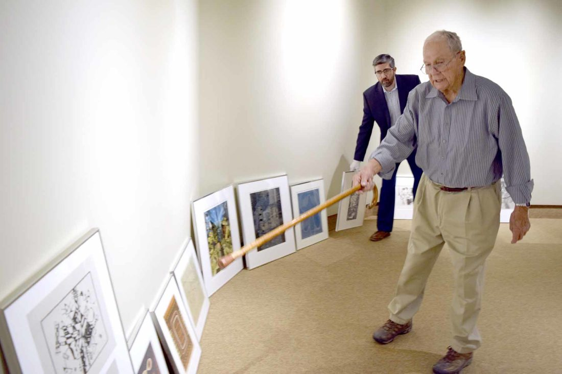 -Messenger photo by Joe Sutter  Artist Richard Black explains how to organize his prints and paper colle art pieces to Blanden Director Eric Anderson, as they prepare for the gallery which will open to the public in December.