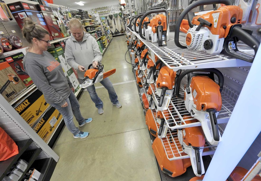 -Messenger photo by Hans Madsen  Sales staff Michele McKinney, left, and Amy Wold look over a new Stihl chainsaw at the recently opened Hardware Hank affilitated Iowa Outdoors Hardware and Rental. They are located at Third Avenue Northwest and U.S. Highway 169 in Fort Dodge.
