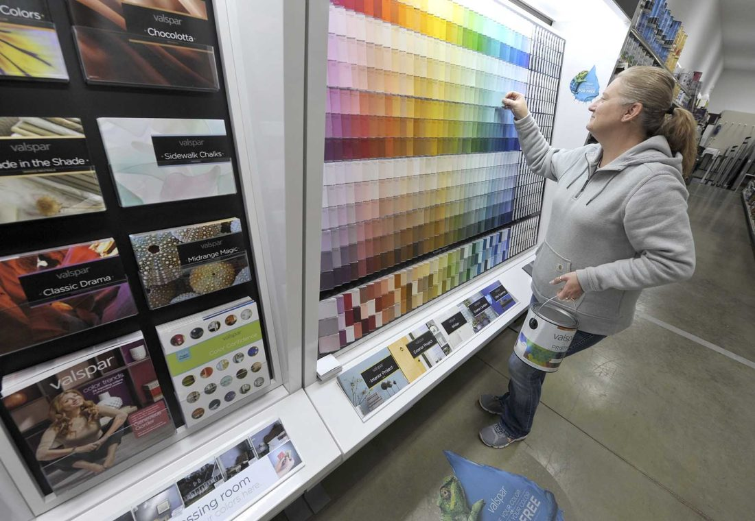 -Messenger photo by Hans MadsenSales staff Amy Wold is ready to help customers at the newly opened Hardware Hank affiliated Iowa Outdoors Hardware and Rental get just the right shade of Valspar paint for their projects.