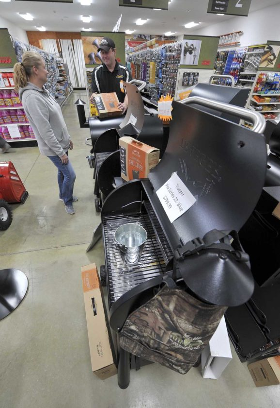 -Messenger photo by Hans MadsenSales staff Amy Wold and manager Aaron McKinney look over the selection of Traeger grills and accessories at the Hardware Hank affilitated Iowa Outdoors Hardware and Rental.