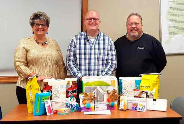 Daybreak Rotary recently raised funds and supplies for Almost Home and presented them to the shelter on Oct. 31. Andrea Swanstrom, Chad Hammar and Tom Kramer are pictured.