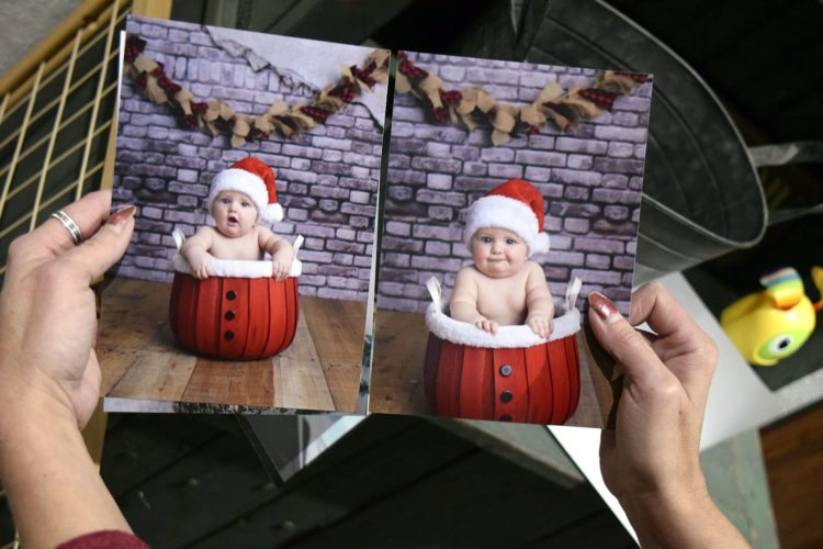-Messenger photo by Joe Sutter  Photographer Dani Rees holds pictures of her grandson, Trace Rees, 6 months, that she took in her home studio. Rees is taking family portraits to raise money for the Shoot for Magic project, by Mid-Iowa Towing, which will give out money to families in need this Christmas. Dani and Mike Rees own Mid-Iowa Towing.