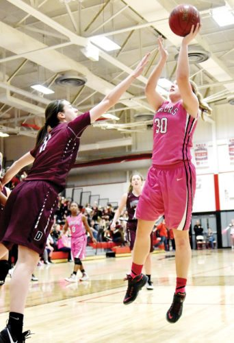 Messenger photo by Britt Kudla  Liza Van Zyl of Fort Dodge shoots last year in the Dodger gym against Dowling.