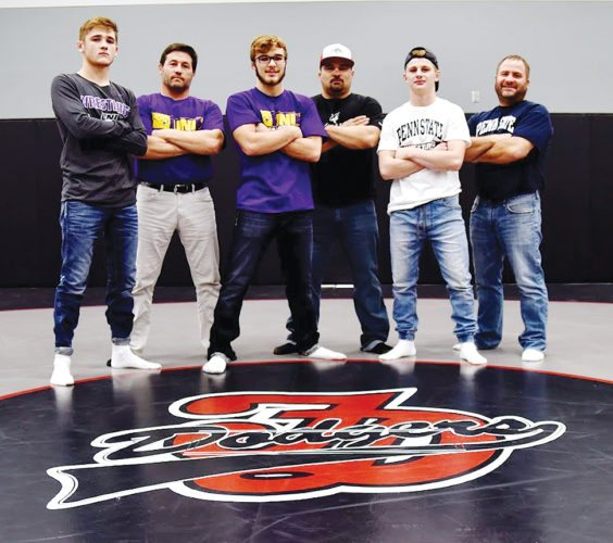 Messenger photo by Britt Kudla  Three of Fort Dodge's six father-son duos this season (left to right):Drew and Troy Bennett, Cayd and Nick Lara, and Brody and Dan Teske. Brody Teske, Cayd Lara and Drew Bennett are all seniors and Div. Iwrestling recruits.