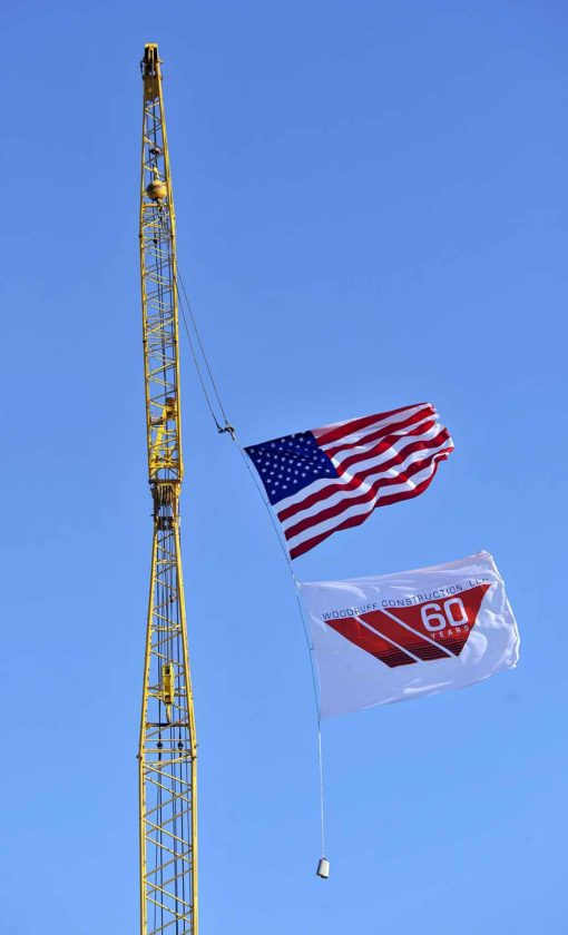 -Messenger photo by Hans Madsen  The Woodruff Construction flag flies proudly under the U.S. flag at the new MidAmerican Energy Customer Office and Service Center Tuesday.