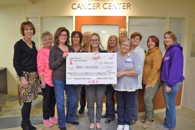 The Angel Ride to Save the TaTas recently presented the Trinity Cancer Center a check for $32,984.25 from their 2017 fundraising events. The group has provided $289,598.61 to support breast cancer patients since 2007. Pictured from left are Carol Grannon, Deb Schuh, Shirley Hottman, Val Clark, Angie McLimans, Christen Sewell, Megan Hanna, Patty Grossnickle, Emily McCollum, Dawn Wesley, Rhonda Nelson and Ali Berger.