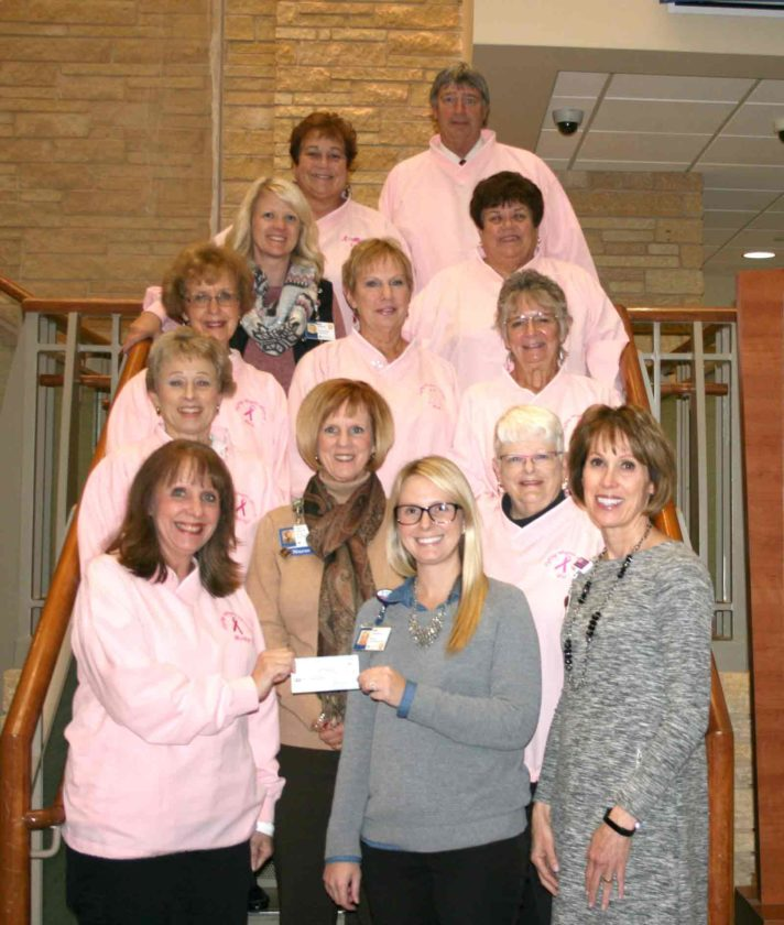 The Fighting Angels Abreast Dragon Boat Team recently presented Trinity Cancer Center a check for $7,000 to support cancer services. This check represented proceeds from the Badger Lake Dragon Boat Association Festival. The Fighting Angels Abreast Dragon Boat Team have been supporting the Trinity Cancer Center since 2012. Pictured from left beginning in front are Marilyn Meier, Christen Sewell, Carol Grannon, Linda Whaley, Pat Hassett, Cheryl Lychwick, Doris Wesley, Deb Diemer, Deb Schuh, Emily McCollum, Barb Michaels, Linda Donner and Tom Donner.