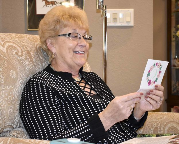 -Messenger photo by Chad Thompson  Delpha Holtzman, of Fort Dodge, reads a letter from a former student at her home recently. She taught in the Fort Dodge Community School District for 35 years.