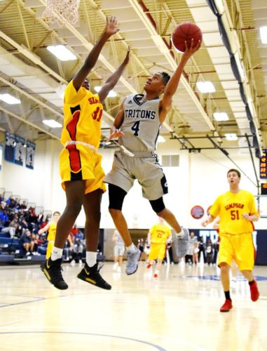 Messenger photo by Britt Kudla  Tray Croft of Iowa Central shoots over Simpson's Ahmed Musa on Monday inside Hodges Fieldhouse.