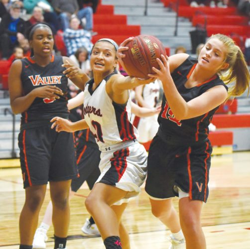 -Messenger photo by Britt Kudla Ebonee Altmann of Fort Dodge fights for a loose ball against WDM Valley Grace Hinkle on Tuesday