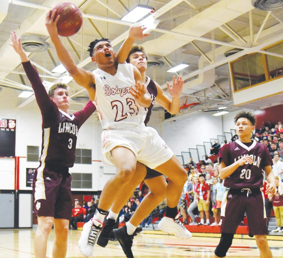 -Messenger photo by Britt Kudla Kaleb Jondle of Fort Dodge shoots around DM Lincoln on Friday
