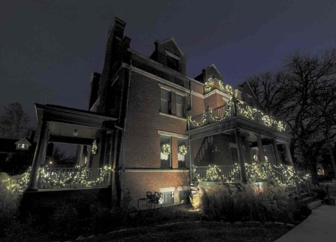 -Messenger photo by Hans Madsen  The Ringland-Smeltzer House is decorated for the holiday season with a mix of pine garlands and white lights.
