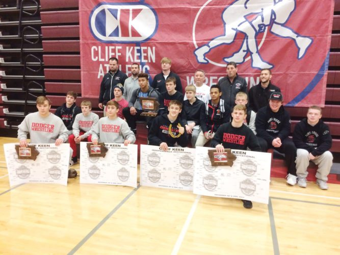 Submitted photo/Lars Underbakke  The Fort Dodge wrestling team poses with its hardware after winning the Cliff Keen Independence Invitational on Saturday.