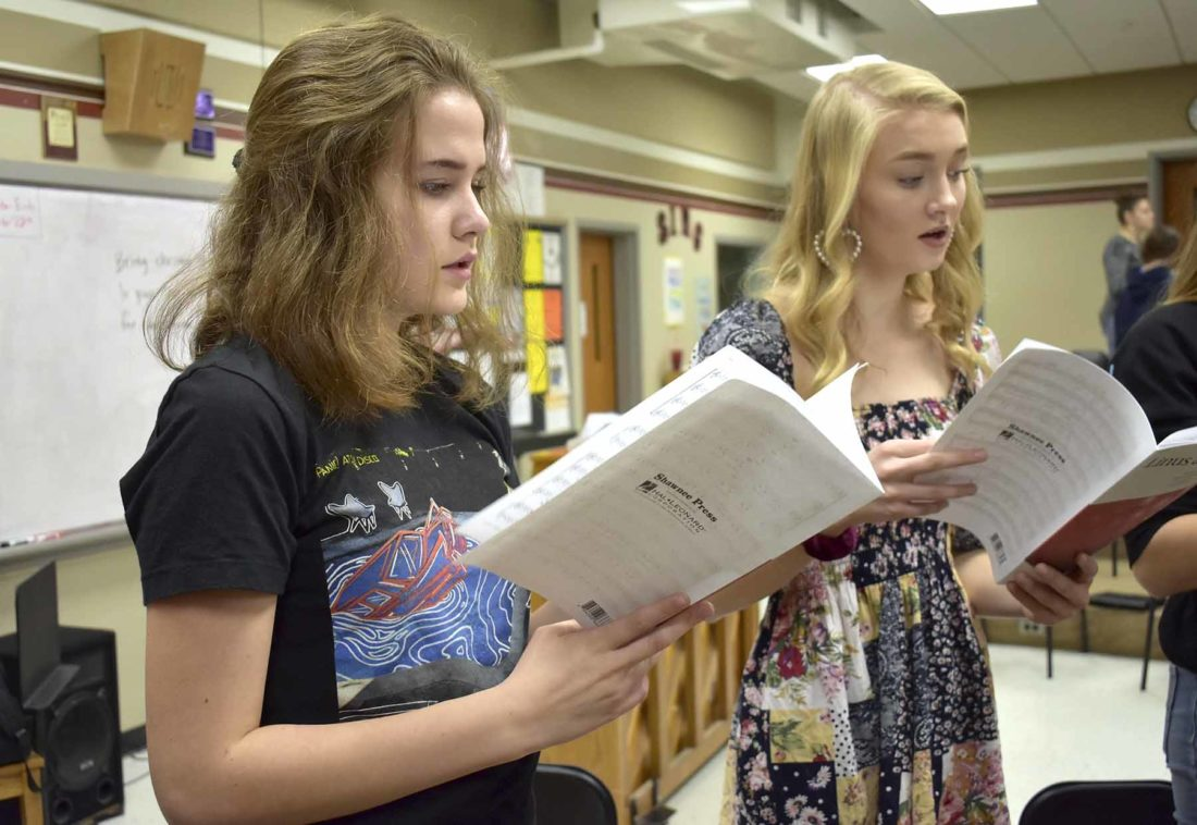 -Messenger photo by Chad Thompson  Grace Champagne, a sophomore at Fort Dodge Senior High, left, and Ona Roe, a junior, rehearse during Kim Wankum's women's chorale class recently.