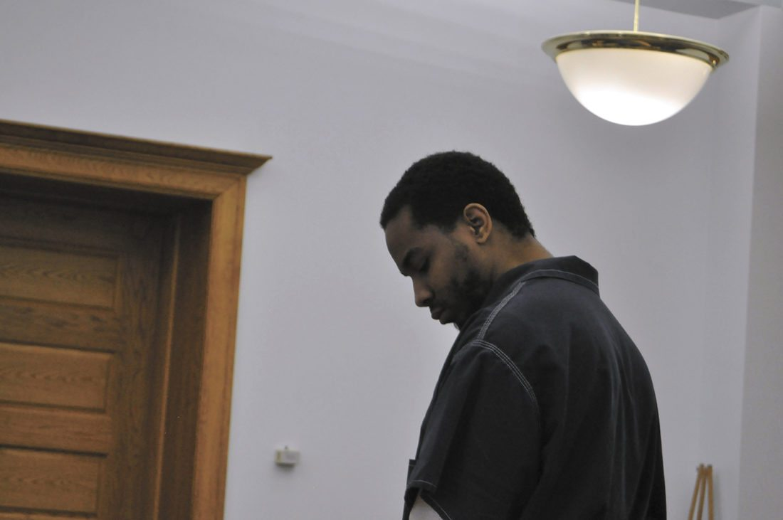-Messenger photo by Peter Kaspari  Gregory Pulley Jr. looks down during his guilty plea hearing in Webster County District Court Monday. Pulley pleaded guilty to attempted murder and intimidation with a dangerous weapon in connection with two 2016 shootings. He also pleaded guilty to trafficking in stolen weapons.