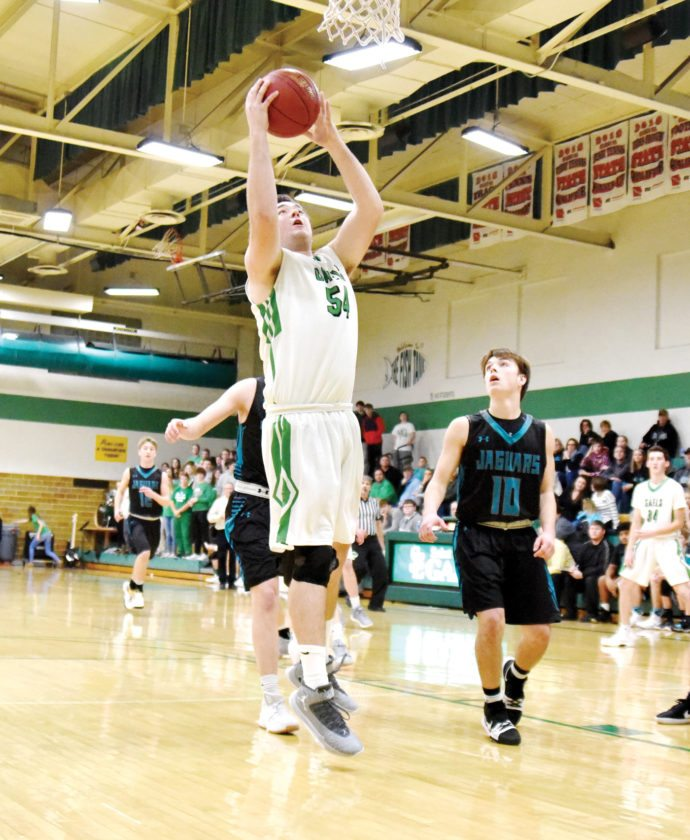 Messenger photo by Britt Kudla  Sean Flaherty pulls down a rebound for St. Edmond against Southeast Valley on Tuesday in the Gael gym. For more photos, please visit CU.messengernews.net