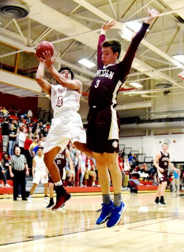 Messsenger photo by Britt Kudla  Malcolm Clayton of Fort Dodge shoots around Des Moines Lincoln Will Feller last week in the Dodger gym.